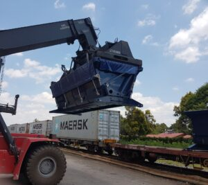 SCA intermodal side tipper bin being loaded onto rail wagon by container handler 2019